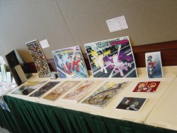 My Art Show table full of prints.