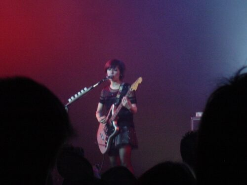 Aimi, the vocalist and lead guitarist.