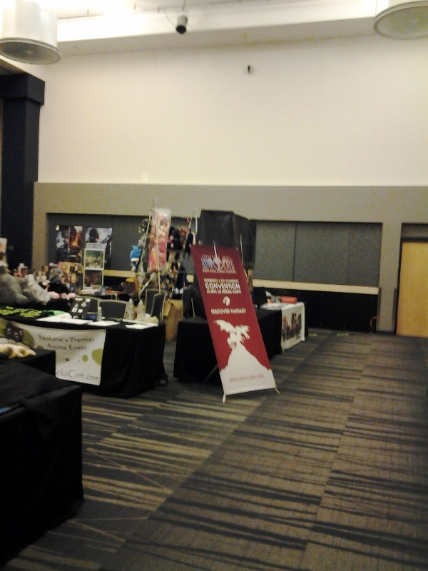 KuroNekoCon's con table in the Dealer's Room area.