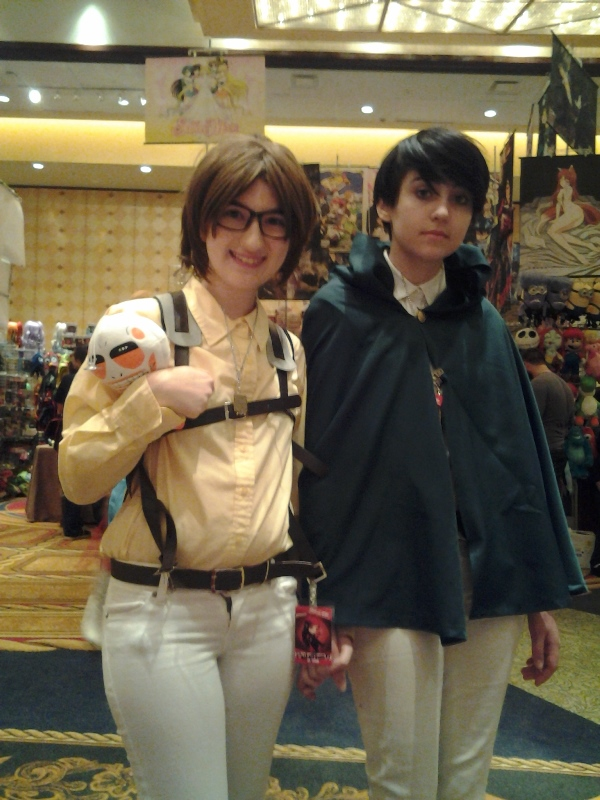 Hanji and Levi. I got a kick out of the fact that on Sunday, almost all the AoT cosplayers just didn't bother with the 3DMG harness. XD