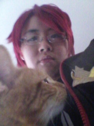 Hi, this is me cosplaying Rin. Also that's my cat Rin. Yes, I named my cat Rin. Shhh.