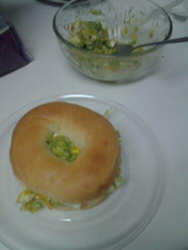 Avocado, egg, & cheese bagel sandwich.