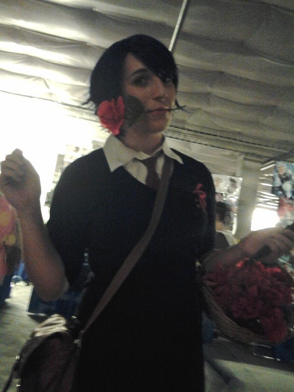 A very sweet Kashima cosplayer (who gave me a rose from her basket), but note the crap lighting in front of our table.