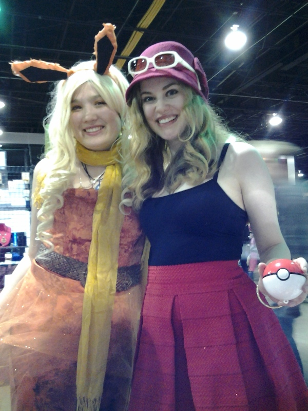A trainer and her Flareon.