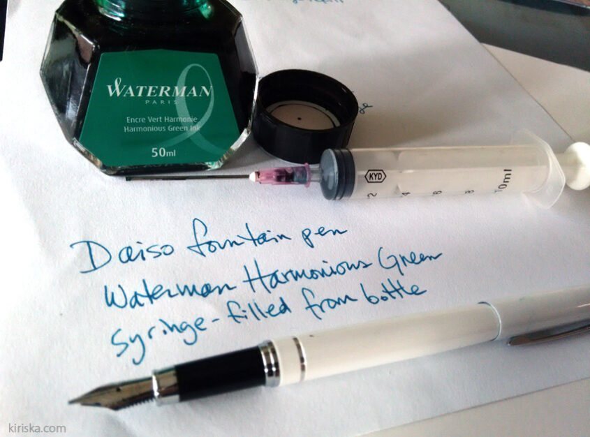 Syringe-filled Daiso fountain pen with bottled Waterman ink.