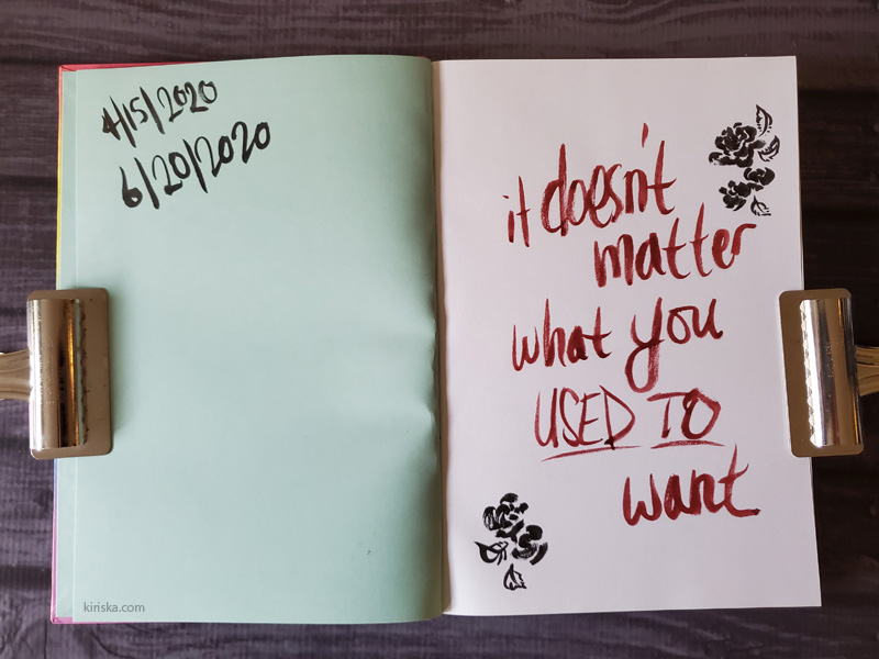 Sketchbook opened to first page with a quote written.