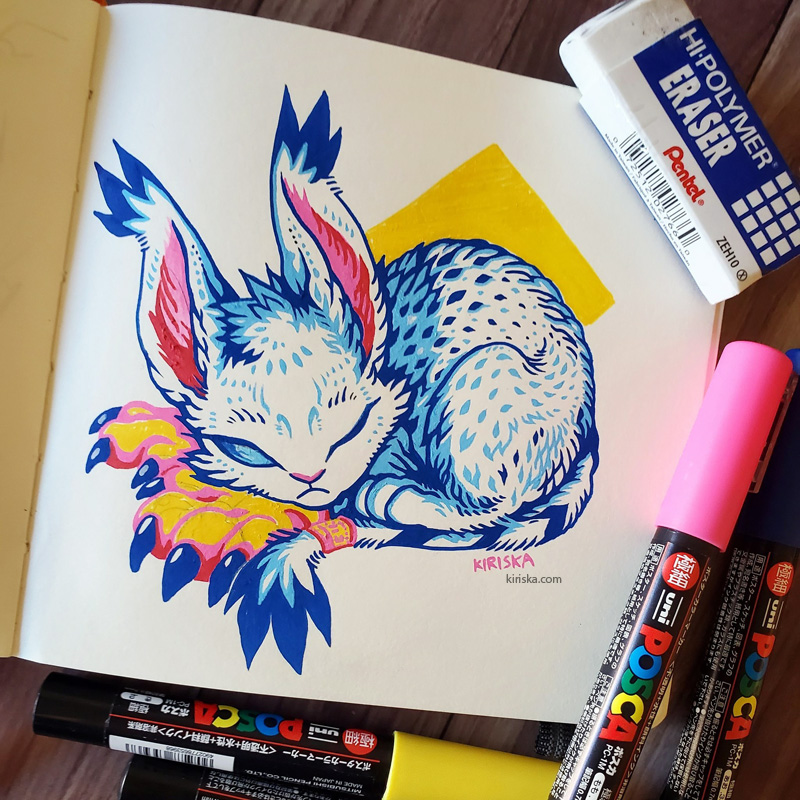 Open sketchbook page with a Posca drawing of Gatomon/Tailmon