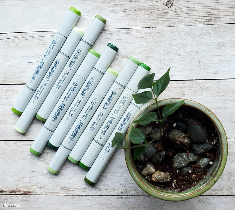 A bunch of green Copic Sketch markers